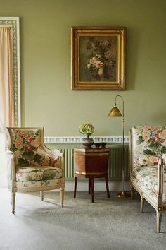 Drawing room with chintz furniture in Living Room Design Ideas. Traditional country living room with pale green walls, gilt picture frame and floral chintz furniture.