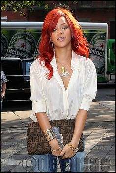A casually dressed Rihanna looking lovely in New York on Wednesday 20 July 2011.    Rihanna made her way into a office building for a photo shoot wearing a white blouse, Armani Jeans, nude Christian Louboutin heels and a Fendi Zucca Clutch.    UK's exclusive luxury authentic handbag SPA  Visit us on Facebook: www.facebook.com/DelortaeAgency