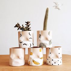 BY ISAAC NICHOLS Melons, cans, jugs no matter what you call them breasts are the best! So don't be a boob and miss out on one of the cutest pots going around. Your indoor greenery will look fabulous in these hand formed and painted tan clay planters from Brooklyn based ceramicist Isaac Nichols. Available in a variety of patterns, we're absolutely bananas for these planters! 12cm x 12cm in size.