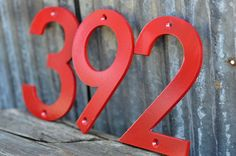 Red - Powder Coated Aluminum Numbers with matching screws by DropMetal on Etsy https://www.etsy.com/listing/270612627/red-powder-coated-aluminum-numbers-with