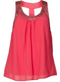 Combineer een roze top met glitters met jeans en een paar killer heels. Alleen een paar zilveren oorbellen en armbanden en een mooi ladylike handtasje zijn nodig om de look compleet te maken