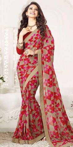 Dynamic Beige And Pink Printed Silk Saree.