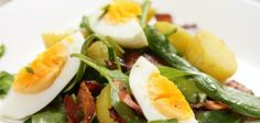 This bacon and egg potato salad is great as a side dish, along side meats or with bread. Scatter with bacon, spring onions and chives and decorate with egg quarters.