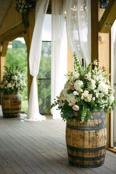 Entrance to our cocktail hour for our wedding. Going to use old wine barrels that my father has collected over the years. Rustic Wedding Idea: wine barrels with opulent bouquets - Pink Barn Wedding by Kristin Sweeting - Southern Weddings Magazine