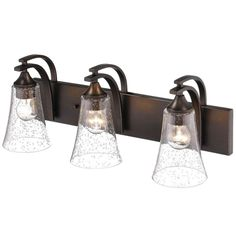 """Millennium Lighting 1493 Natalie 3 Light 24"""" Wide Bathroom Vanity Light Features       Features seeded glass shades   (3) 100 watt medium (E26) bulbs required   Recommended for use with Vintage Edison bulbs   UL rated for damp locations      Dimensions       Height: 10""""   Width: 24""""   Extension: 8-1/4""""   Depth: 8-1/4""""      Electrical Specifications       Max Wattage: 300 watts   Number of Bulbs: 3   Max Watts Per Bulb: 100 watts   Bulb Base: Medium (E26)   Bulbs Included: No"""