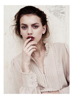 I like the light makeup & dark lipstick contrast, blouse is sooooo vintage French!