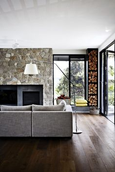 "The chimneybreast, made from the same local stone used elsewhere, has been extended to accommodate a niche for the television. Ali **armchairs**, [Lounge Designer Furniture](http://www.lounge.net.au/?utm_campaign=supplier/|target=""_blank""). **Side table**, [Jardan](http://www.jardan.com.au/?utm_campaign=supplier/