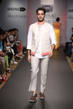 """Sonam and Paras Modi hit some high notes with this clean and classy look in their rustic-chic collection that they titled """"Kasi."""" The peach accents are the perfect means to color coordinate with a significant other's outfit without going overboard."""