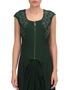Bottle green short sleeves kurta featuring scoop neckline with zipper on front and asymmetric hemline. Adorned with heavy floral embroidery on shoulders with beads and gunmetal. Drape pants featuring flowy drapes on front included. Wash Care: Dry Clean Only