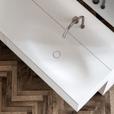 For free-flowing motion, the Timeless washbasin has a subtle oval shape that blends seamlessly into the countertop. Not being bound to trends, the Timeless washbasin does exactly what its name promises. Completely made to measure out of HI-MACS (solid surface). Featured: Timeless basin integrated top with matching HI-MACS (Alpine white) cabinet. bathsbyclay.com