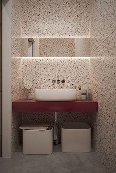 Bathroom with terrazzo walls + burgundy counter