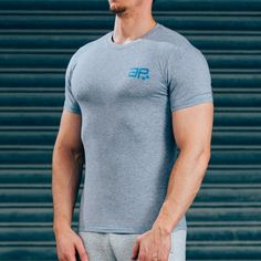 FormFit T-Shirt - Grey & BlueShipping: PROCESSING TIME 3 - 4 Days ESTIMATED DELIVERY TIME 3 - 4 days for Domestic 4 - 6 days for International Superior quality cotton t-shirt, simple design, tapered fit to showcase your physique. Designed with quality in mind, the same great feel after multiple washes, good as new for years to come. Styled for all day wear: complete with blue printed logos & contrast stitching. #Musclesnotincluded 95% cotton, 5% Elastane Model is 5'11'' and wears an M…