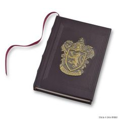 WARNER BROS. STUDIO TOUR - STORE -  Gryffindor™ Metal Crest Journal £18.95................This journal features a gold metal coloured Gryffindor™ crest on a black faux-leather cover. A scarlet ribbon marks your place within the white pages