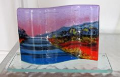 Follow the Winding Road, curved fused glass panel on clear glass base.  Alice Benvie Gebhart