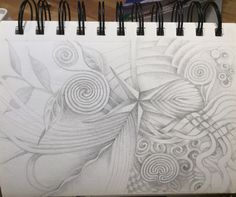 Spiral drawing. Start with an image in the centre and keep adding until you circle your way all around the page