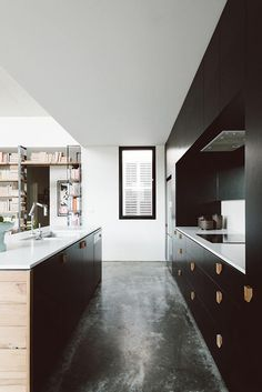 Burnished concrete floors and black cabinetry make for a modern kitchen. Northrop House by Techne Architects Interior Exterior, Kitchen Interior, Kitchen Decor, Classic Kitchen, New Kitchen, Kitchen White, Kitchen Magic, Attic Renovation, Attic Remodel
