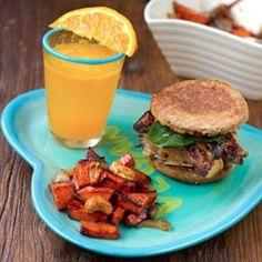 Vegan Mushroom Melt Breakfast Sandwich with spiced sweet potato home fries and fresh OJ.