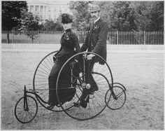Smartly dressed couple seated on an 1886-model bicycle for two, in Washington, DC.  Photo Credit: National Archives
