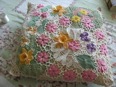 Embellished pillow | I used doilies and other crocheted pieces that were cut from doilies.