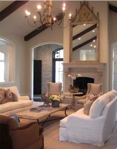 TG interiors: Arteriors and Lisa Luby Ryan - like the coffee table stone slab and neutral colors.