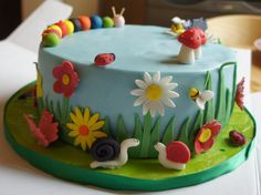 Cool cake idea for a spring cake, makes me want to learn how to make marzipan figures and decorations.