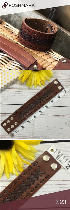Faux Leather Brown Wide Braided Cuff Bracelet Wide brown faux leather, wide, braided, adjustable bracelet with silver buckles. New in package. Smoke free home. 🌺Thank you for shopping my closet 😊🌺 Jewelry Bracelets