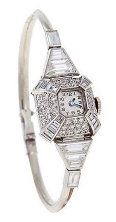 Uti Lady's Platinum, White Gold and Diamond Bracelet Watch, Switzerland circa 1935.