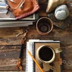 Desk: Keychain, notebooks and coffee