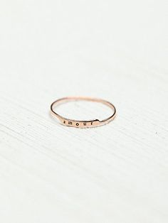 "Etched Letter Ring | Delicate 14K gold ring with simple band and either an etched heart or the words ""amour"" on the front..  *By Bittersweet"