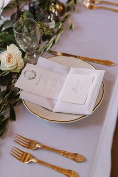 Gold rim plates, white plates, gold flatware, silverware, wedding table setting, place setting, name cards, torn edge, crest, simple wedding decor.