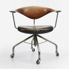 fantasticfrankblogg:    gregmelander:    HANS WEGNER  Swivel desk chair Johannes Hansen Denmark, 1955 see more shots here.    Puh. Office.