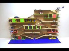 DIY Garage for cars with slides from cardboard Cardboard Houses For Kids, Cardboard Car, Cardboard Box Crafts, Kids Car Garage, Toy Garage, Family Tree Wall Decor, Kids Wall Decor, Backyard For Kids, Diy For Kids