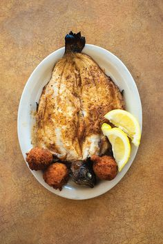 18 Ways to Make the Most of Cornmeal: Broiled Rainbow Trout with Hush Puppies Fish Dishes, Seafood Dishes, Fish And Seafood, Seafood Recipes, Cooking Recipes, Main Dishes, Saveur Recipes, Rainbow Trout Recipes, Whole Fish Recipes