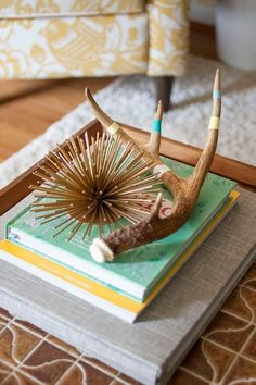 10 Mid-Century Modern DIYs to Give Your Space a Retro Update: This accessory can transform any entry way table or coffee table in your living room. Embellished faux antler DIY is easy and you can find the how-to on site.