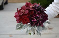 Deep red floral arrangement by  hacman floral #reception #flowers #weddings