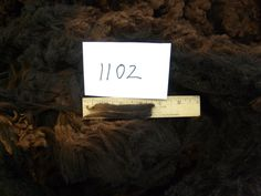 natural colored raw fleece for spinning or felting 1102. $36.00, via Etsy.