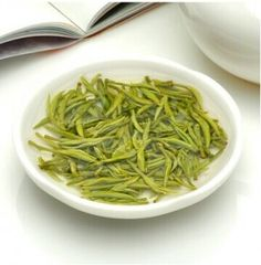 Beautiful tiny, slightly curled tea leaves covered with white down. The liquor is bright yellow in color.
