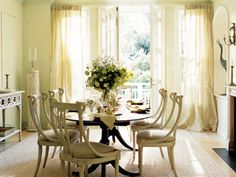 Cream-colored dining room with painted chairs