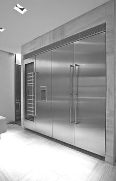 Minimalist interior design kitchen. Really what else could go one this wall. That is a lot or refrigeration/