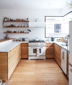 Kitchen Interior Design Remodeling retro white kitchen appliances in kitchen with wood cabinets and white countertops- diy cabinet inspiration? - White kitchen appliances are making a comeback, in case you didn't know Kitchens Without Upper Cabinets, White Kitchen Appliances, Wood Kitchen Cabinets, Kitchen Countertops, Kitchen White, Kitchen Walls, Kitchen Backsplash, Kitchen Sink, Kitchen Island