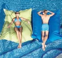 pool pillow. $250 on Brookstone, but it wouldn't be that hard to make. Made from Sunbrella canvas and foam beanbag beads. I want!!