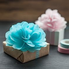 These pretty mini poms or tissue paper flower gift toppers easy to make with my full tutorial. #mothersday