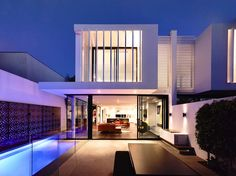 Backyard and facade of Perfect Modern Townhouse by Martin Friedrich Architects at night