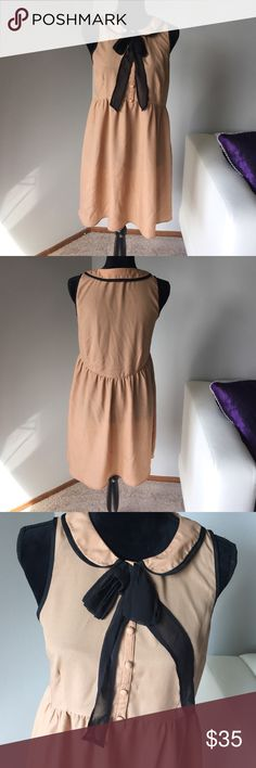 Tan dress with Peter Pan collar Tan dress with Peter Pan collar. Buttons up front. Actual close is a zip on side of dress. Light fabric. Great for summer. And winter with black tights Dresses Mini