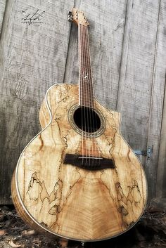 that's an awesome guitar....wish i knew who makes it so i can go to their website and lust after more of their guitars which i'm sure i can't afford.
