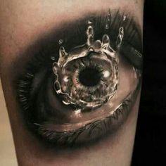 Ever wonder what an eye drop falling in slow motion looks like? #InkedMagazine #hyperrealism #realism #realistic #eye #tattoo #tattoos #Inked #ink #cool #splash