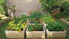 Square fountain in planting bed   Add a little water music to your yard with the just-right idea from our gallery of water features