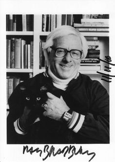 Ray Bradbury holding a black cat, signed and dated (11/11/2000)