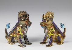 PAIR OF OLD CHINESE GILT SILVER AND ENAMELED SEATED DOGS