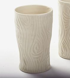 Each porcelain pint glass is wheel thrown and hand-carved – no molds are used. This makes every faux bois pint glass a unique one. Each porcelain class can comfortably hold a pint of beer, tea or lemonade and is finished in a simple clear, glossy glaze.